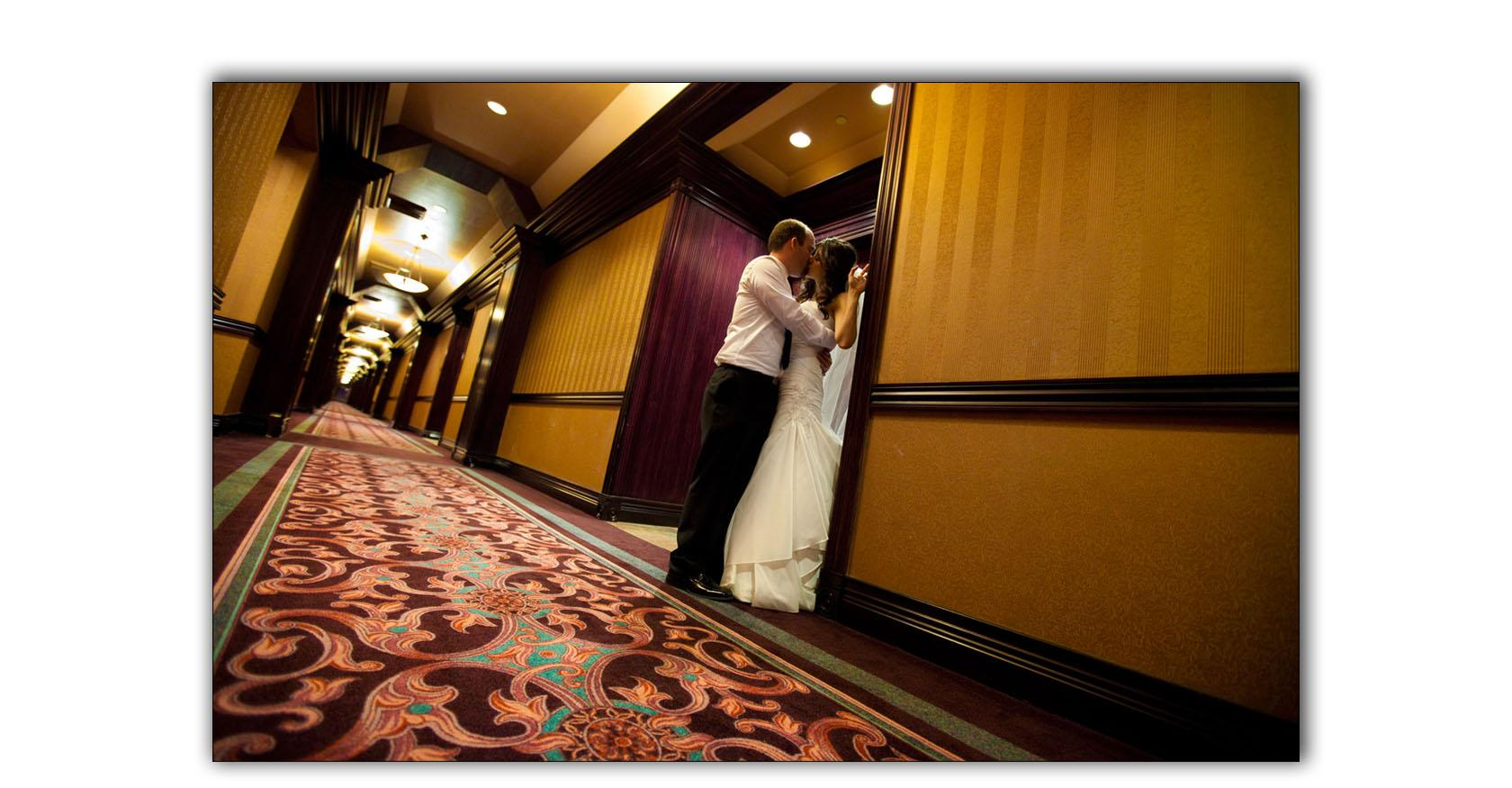 The Orleans, Las Vegas wedding photography, bride and groom kiss