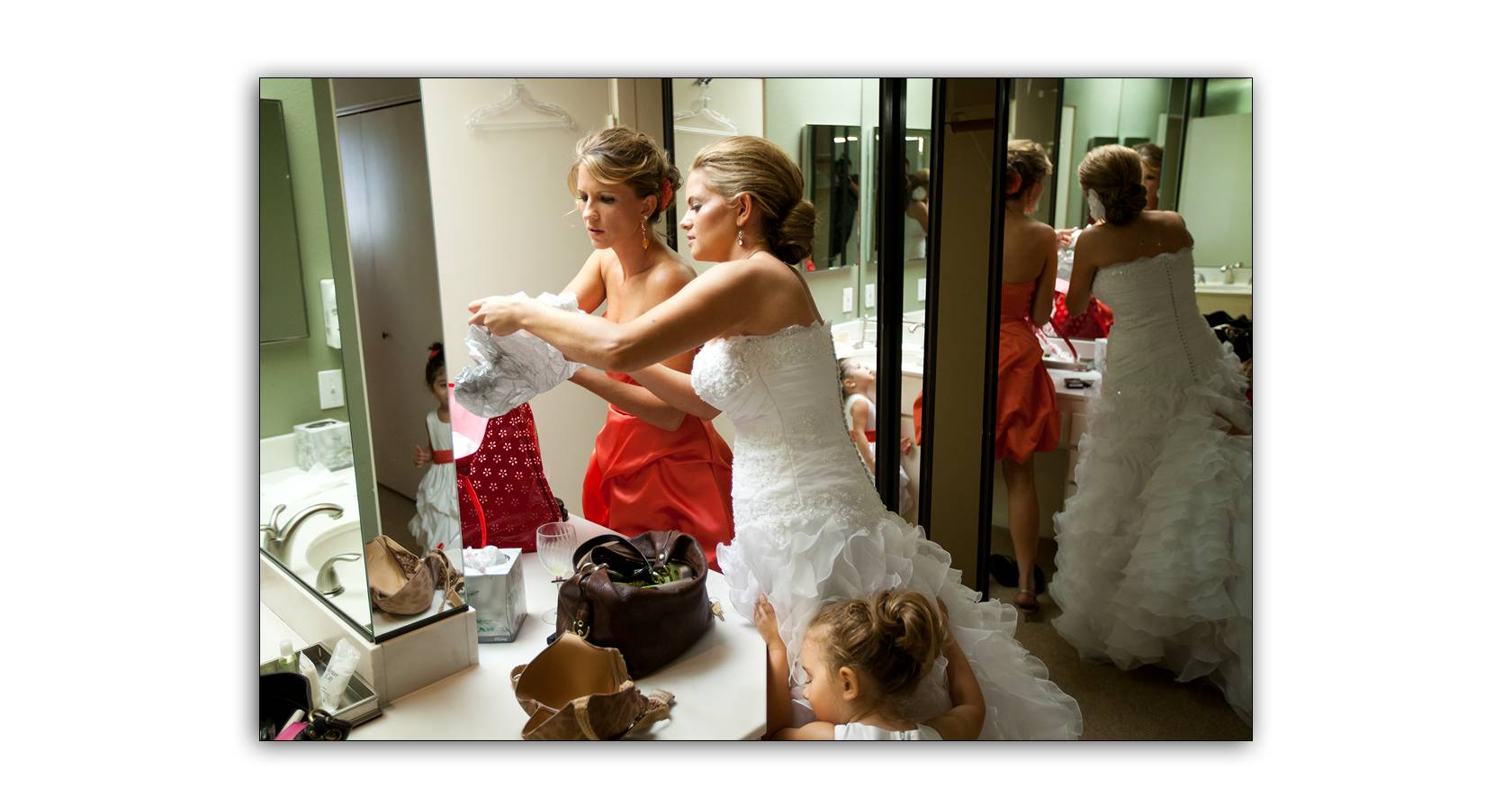 Flower girl hugs bride&#8217;s dress at Mission Hills Palm Springs wedding
